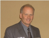 Dr Tom Potisk