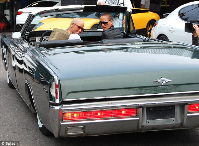 Amber Rose 1966 Lincoln Continental Convertible