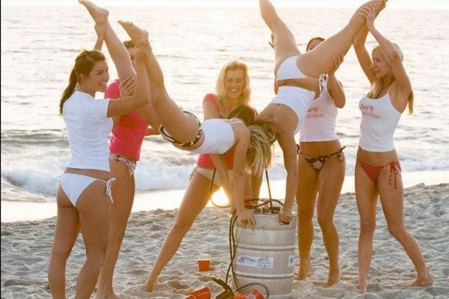 girls on the beach drinking beer
