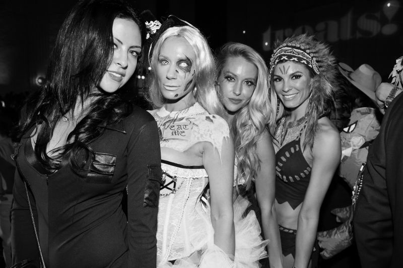 LOS ANGELES, CA - OCTOBER 29: (EDITOR'S NOTE: Image has been converted to black and white) Guests in Halloween costumes attend Trick or treats! - The 6th Annual treats! Magazine Halloween Party Sponsored by Absolut Elyx on October 29, 2016 in Los Angeles, California. (Photo by Gabriel Olsen/WireImage)